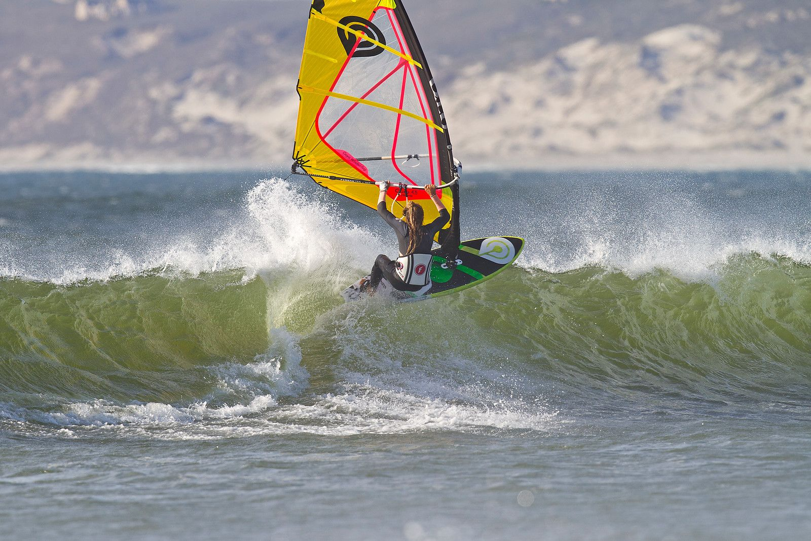 Tony Frey windsurfing and riding a wave on a Goya board